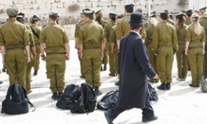 Haredi man walking past soldiers at Kotel. photo courtesy http://failedmessiah.typepad.com