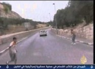 Israeli Settler Runs over Protesting Palestinian Children