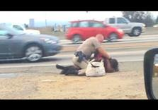 Highway Patrol Officer aims Knockout Punches at Woman along Freeway