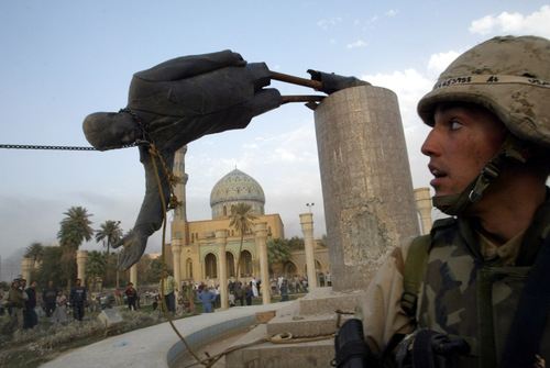 FILE PHOTO OF TOPPLING OF STATUE OF PRESIDENT SADDAM HUSSEIN FALL IN CENTRAL BAGHDAD