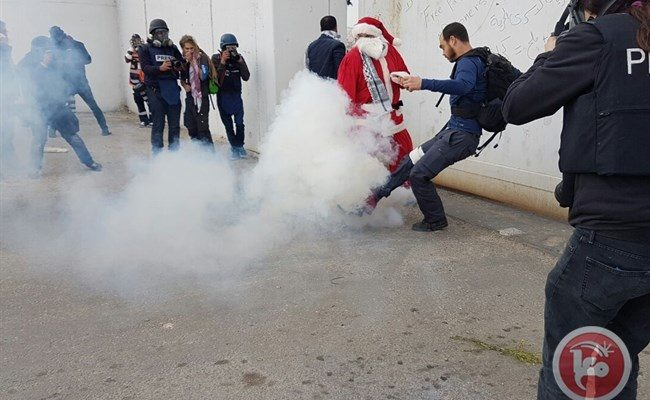 Israeli forces suppress Bethlehem's 'Santa Claus march' with tear gas, rubber bullets